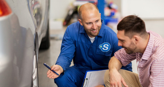 a garage owner and his customer